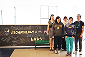 Photo: Anthropology students and professors pose in front of Anthropology welcome sign
