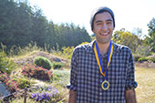 Photo: Anthropology graduate Nick with medal