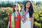 Photo: Anthropology graduates Nina and Sarah with medals