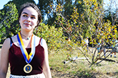 Photo: Anthropology graduate Zoe with medal