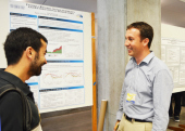 "Eric Fischer, Economics with his poster presentation, ""Federal Reserve Announcements and International Bond Flows."""