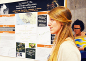 "Justine Smith, Environmental Studies with her poster presentation, ""Scaredy Cats: Human-Induced Fear Alters Predator-Prey Interactions."""